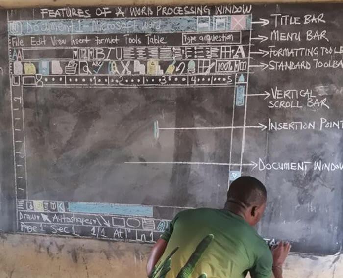 Ghana teacher low tech computer teaching